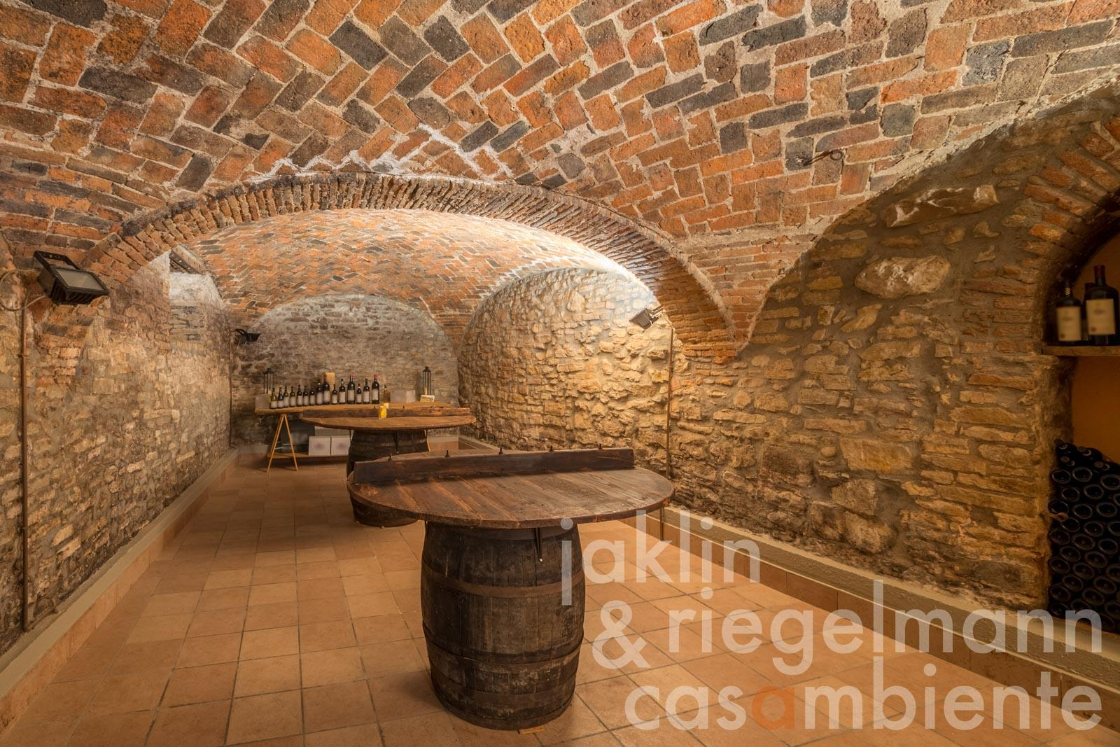 The wine cellar of the Agriturismo for sale with wine production in a protected setting in Piedmont near Acqui Terme