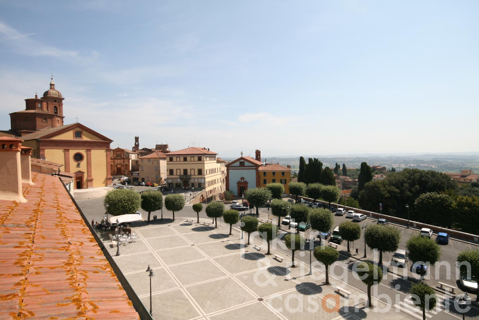 The view across Sinalunga in Tuscany from the roof-deck of the apartment for sale