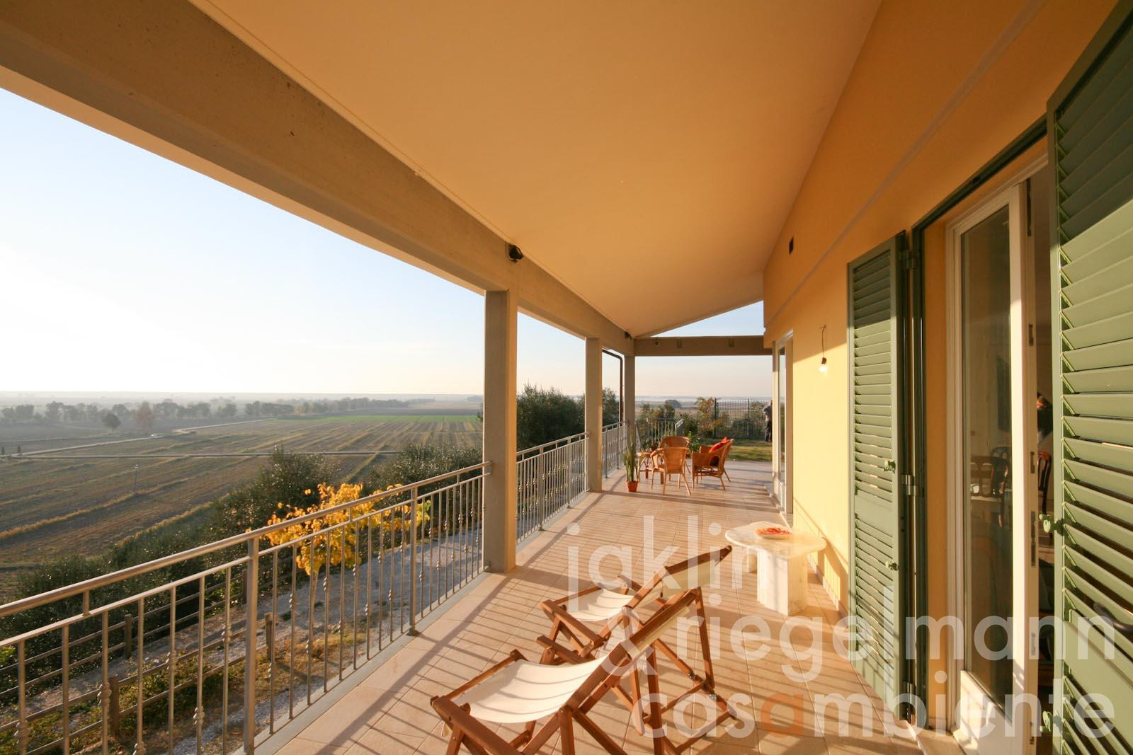 The modern villa for sale with panoramic views across Lago di Massaciuccoli in Tuscany