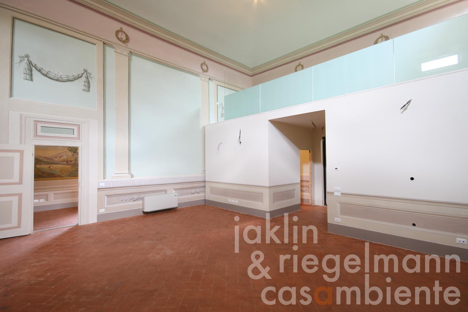 The former ballroom in the apartment in Florence for sale with frescos and gallery