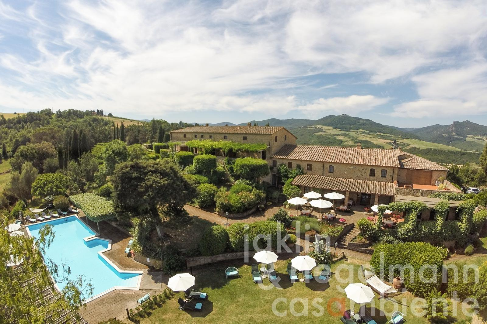 The manor for sale with holiday apartments, pool and garden close to Volterra in Tuscany