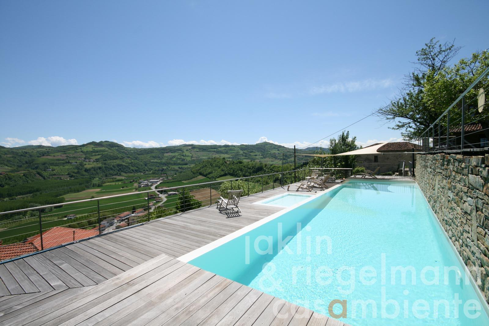 The restored village house for sale with swimming pool and panoramic views in Piedmont