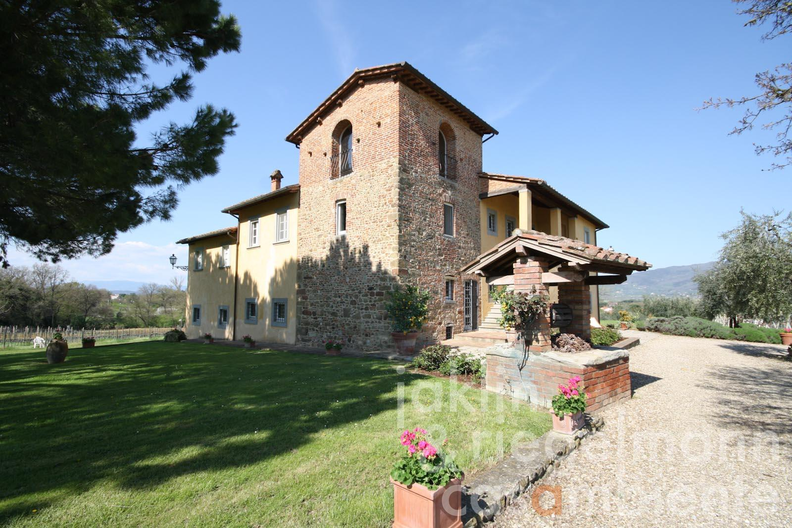 The country estate for sale with 12th century tower, olive grove and vineyard in Tuscany