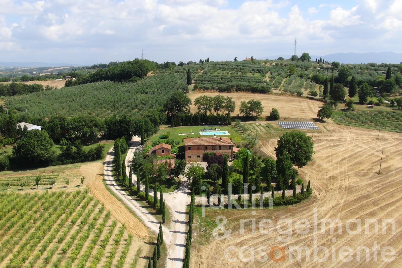 The Agriturismo for sale with typical country house, annexes and pool in Tuscany