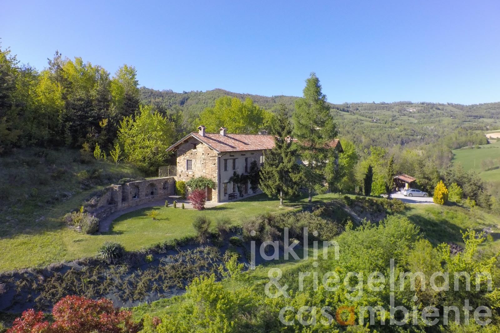 The elaborately restored stone country house for sale in panoramic location in Piedmont
