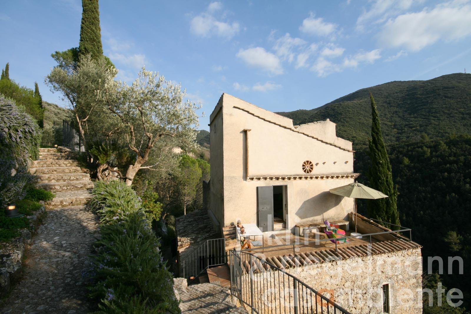 The authentically restored tower for sale with panoramic views onto the town Spoleto in Umbria
