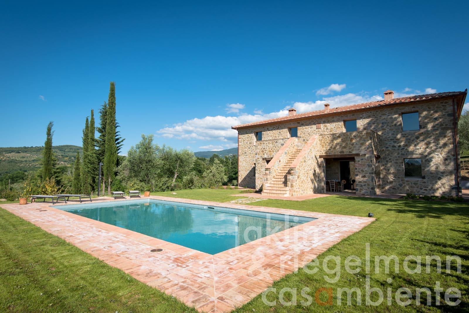 The newly constructed country house for sale in the Maremma with pool and olive grove in panoramic setting
