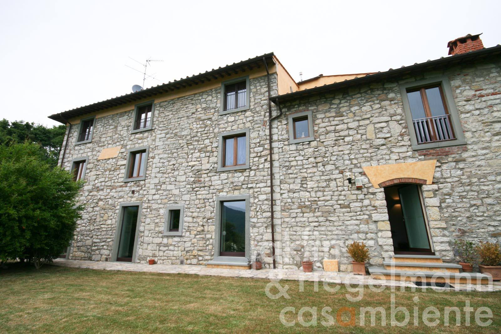 The modern and beautifully restored apartment for sale with private garden close to Florence in Tuscany