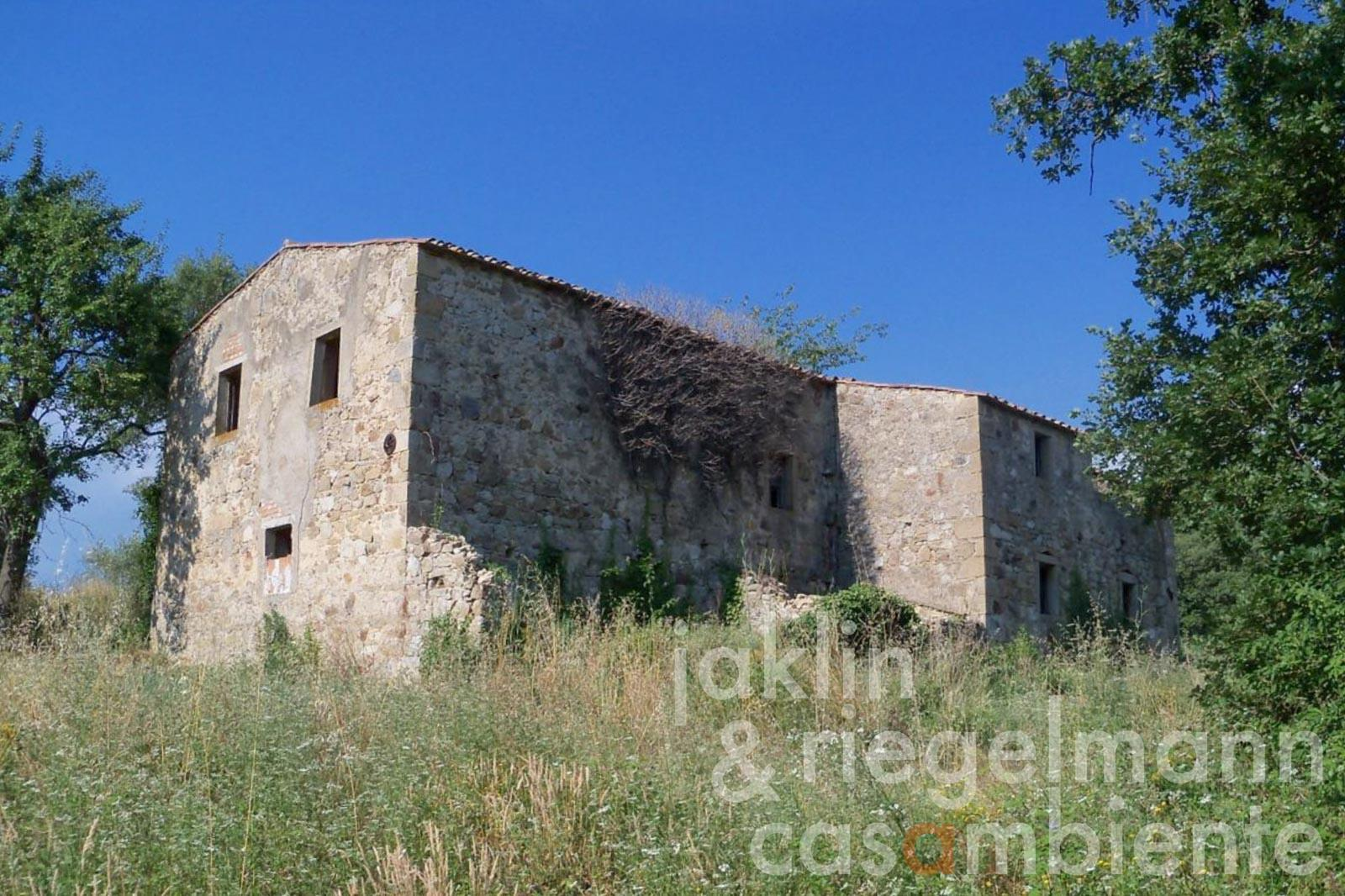 The Tuscan farmhouse to restore for sale with sea view and 34 hectares of land