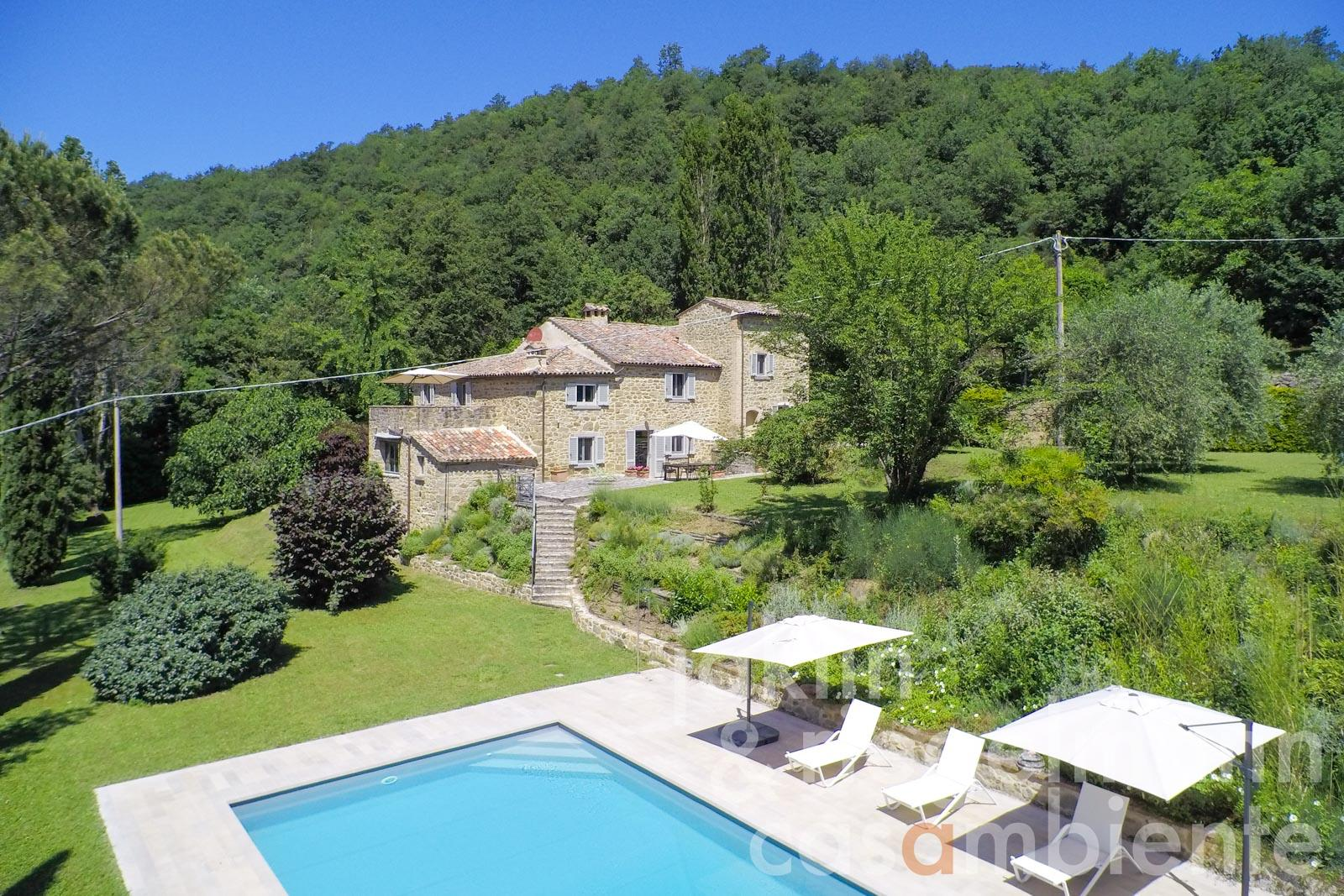 The beautifully restored ancient farmhouse for sale in Tuscany with garden, pool and tennis court
