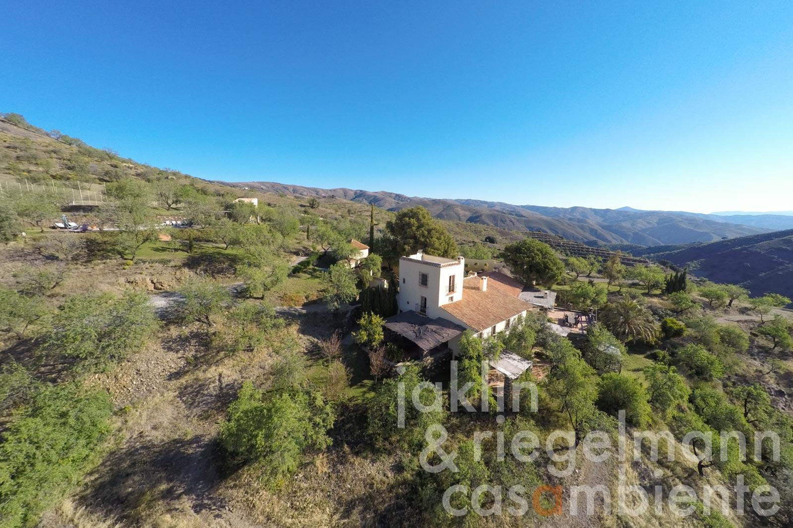 The country estate for sale in the Sierra Nevada in Spain with vineyard, olives, almond trees and sea view