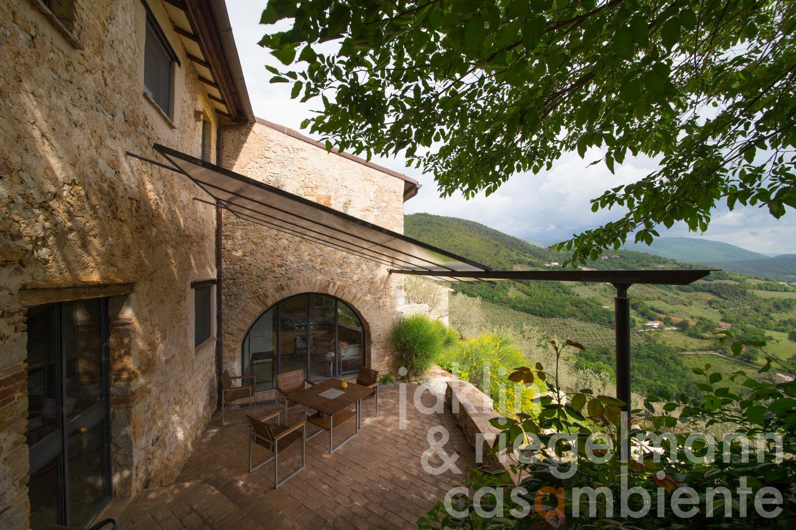 Contemporary architecture in a medieval building with terraces, garden and stunning panoramic views