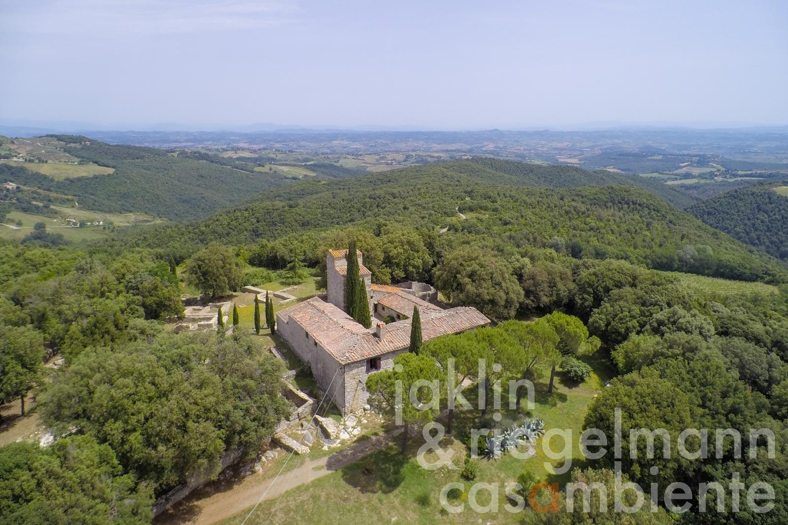 The unique former monastery for sale with tower and panoramic view near San Gimignano in Tuscany