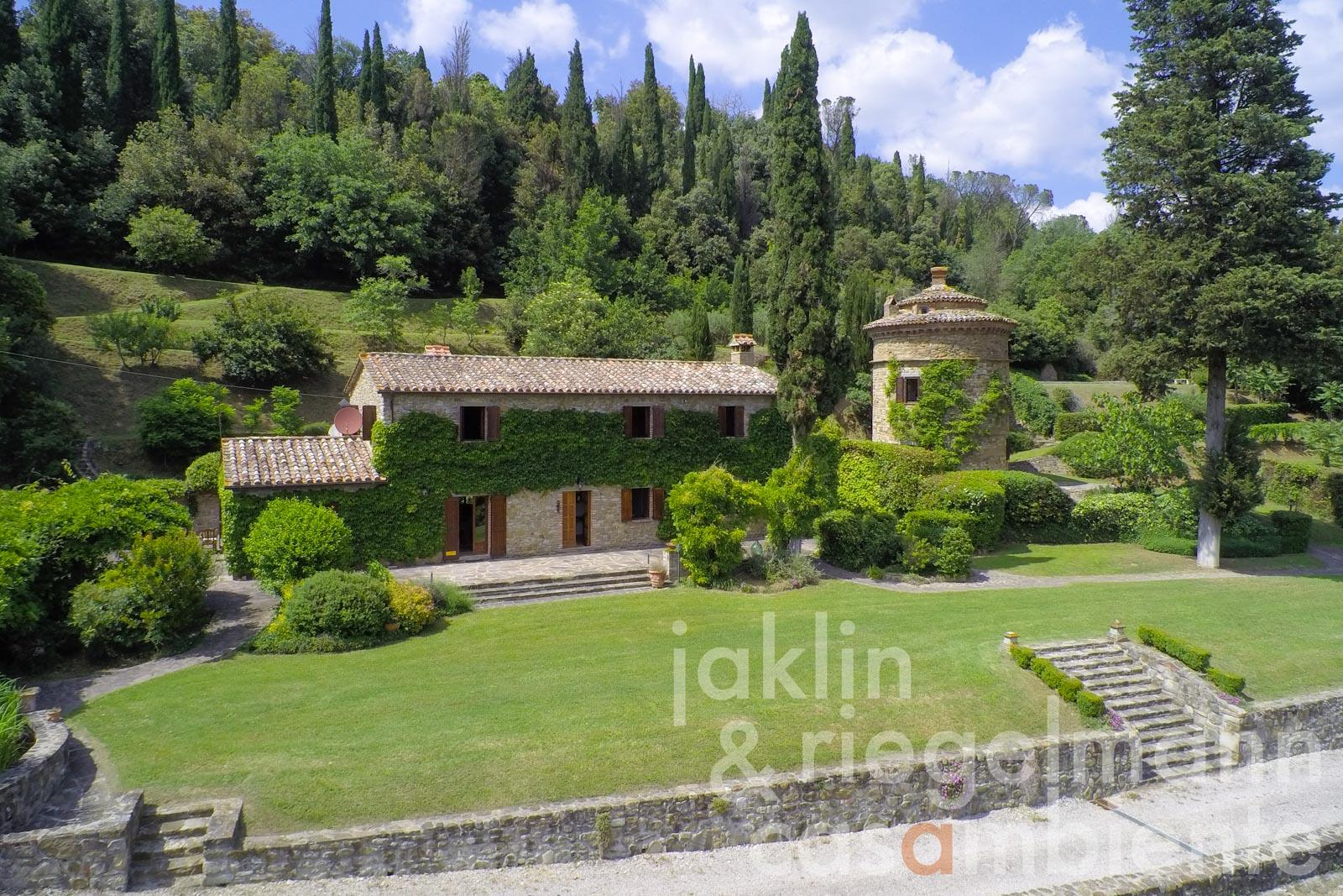 The Mediaeval country estate for sale in Tuscany with country house, tower, pool, garden and stunning views