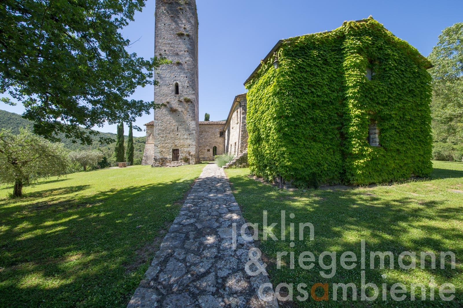 The impressive listed 11th century tower, church and country house with swimming pool and annexe building in Umbria