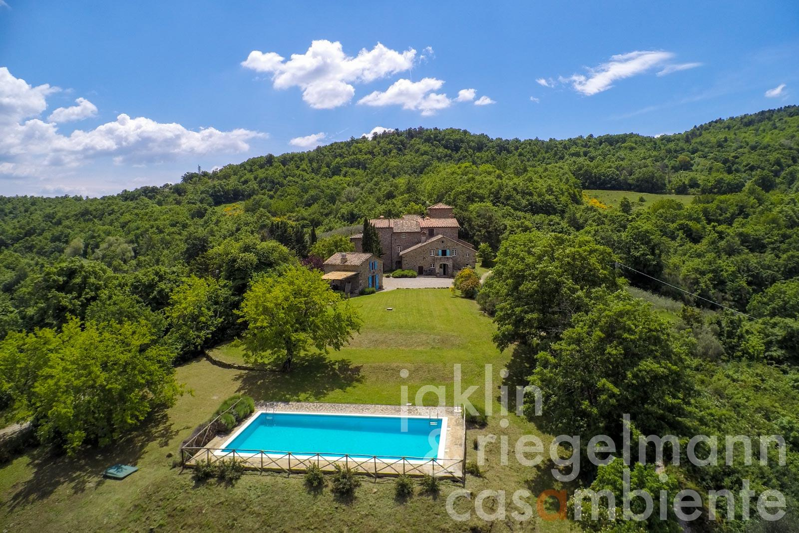 Restored stone property, attached but private, in a medieval hamlet with views, garden and pool