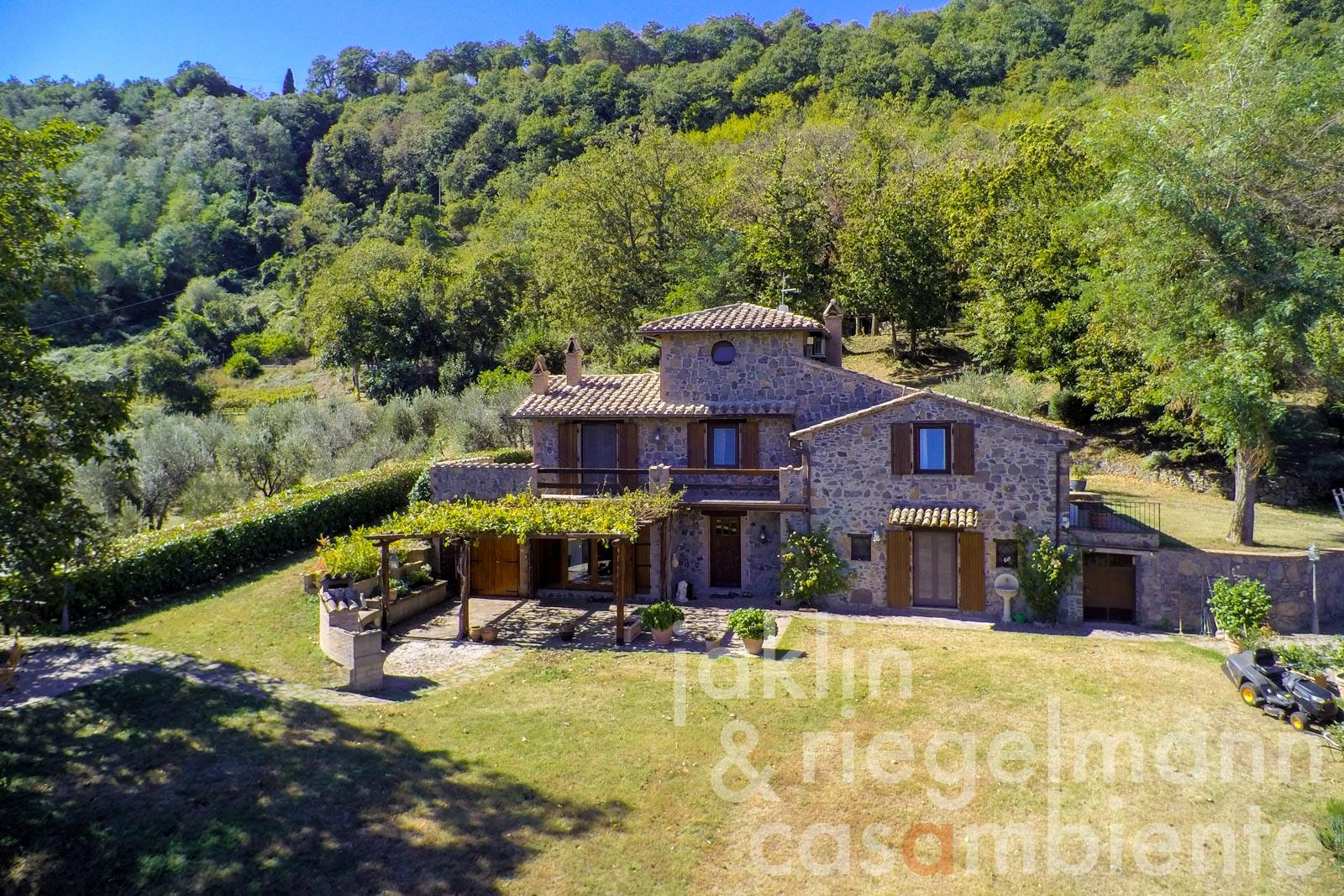 The country house for sale close to Orvieto in Umbria with pool, olive groves, vineyard, and small wine production