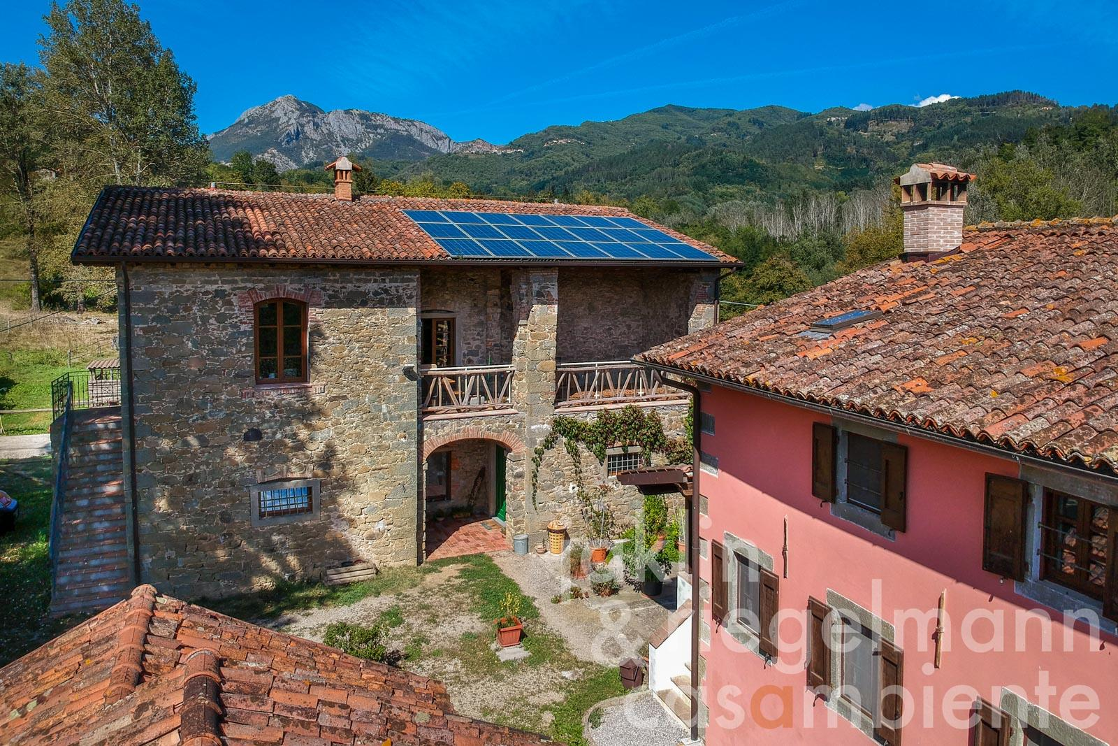 Agriturismo in the hinterland of Lucca in Tuscany with several buildings, pool, equestrian area and 14 ha of land