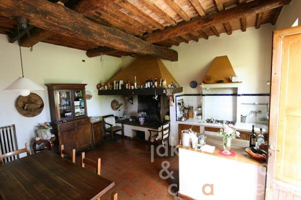 The dining room with kitchen and large open fireplace on the ground floor
