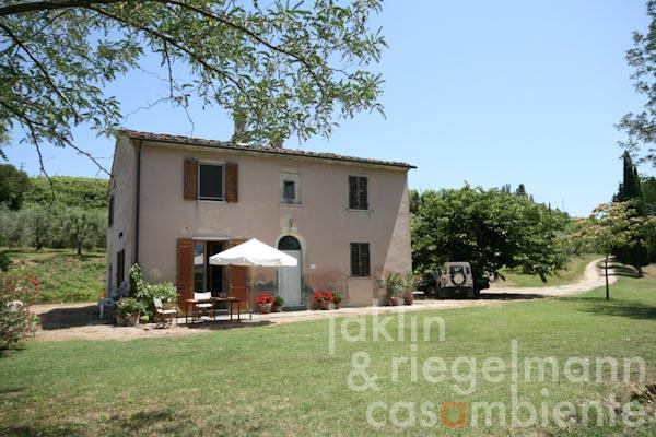 The Tuscan winery's country house for sale with the surrounding garden