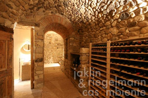 The wine cellar in the main country house; the bathroom on the left