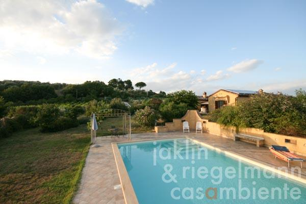 The view from the swimming pool to the country house