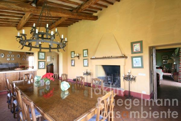 The dining area with open fireplace on the ground floor