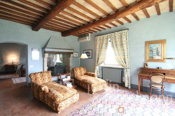 The living area with fireplace of the master bedroom on the first floor