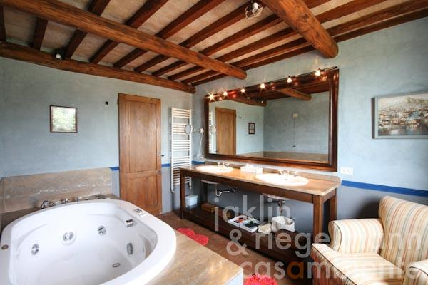 The en-suite bathroom with  Jacuzzi of the master bedroom