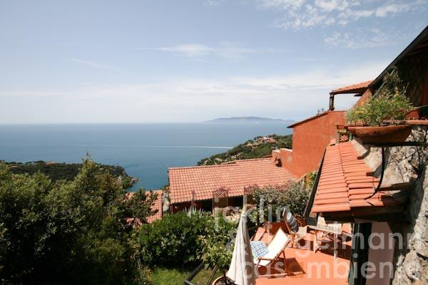 The panoramic view from the terrace across Cala Piccola and Giglio Island