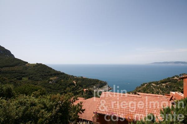 The panoramic view from the large upper terrace across Cala Piccola and Giglio Island