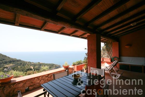 The panoramic view from the large upper terrace across Monte Argentario and the sea