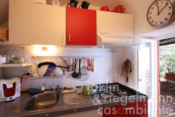 The small kitchen with access to the terrace in the upper apartment