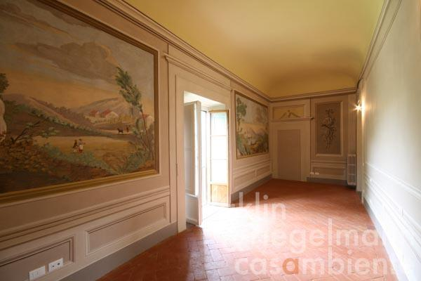 A second bedroom or studio with frescos