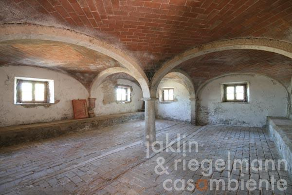 The large room with several vaults on the ground floor
