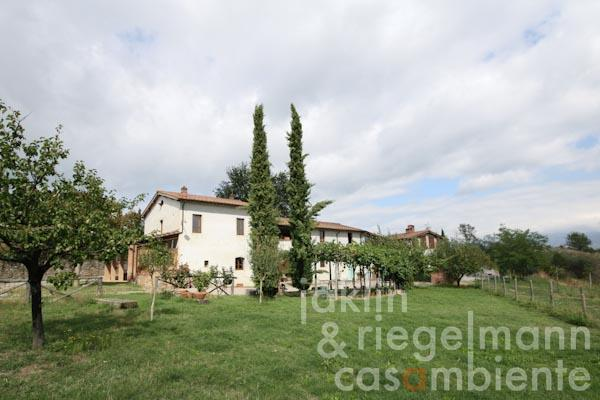 The spacious Italian country house for sale with five apartments and views across Valdarno valley in Tuscany