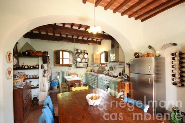 The spacious eat-in kitchen with a beautiful wooden table on the ground floor in the first apartment