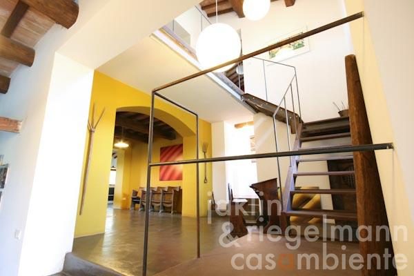 The staircase of the country house for sale with photo studio and modern interior close to Narni in Umbria