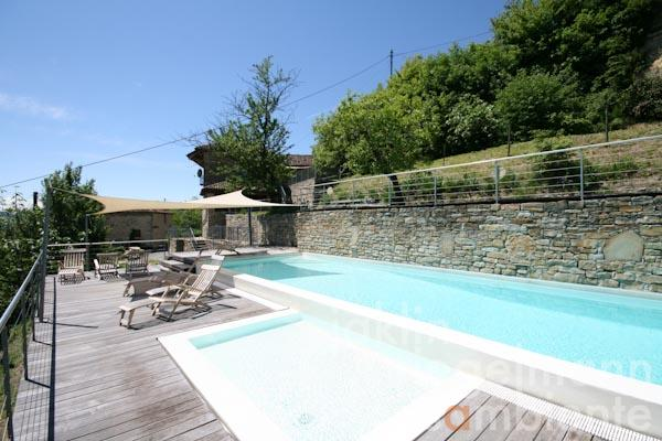The restored village house for sale with the swimming pool and upper terrace