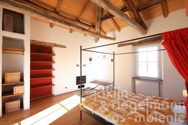 A bedroom with fireplace in the seventh apartment in an annexe building
