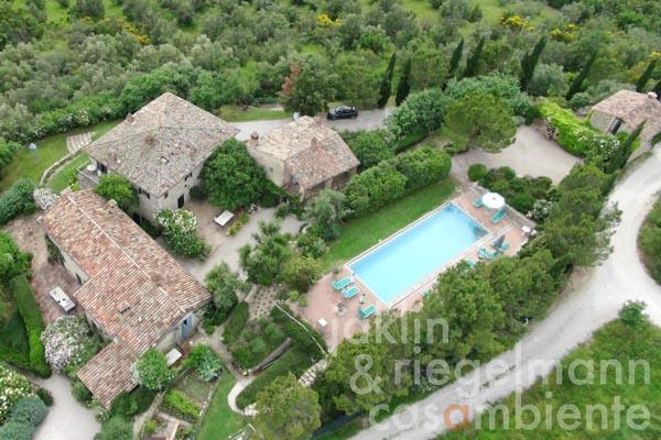 An aerial overview of the property for sale with its four buildings and the swimming pool