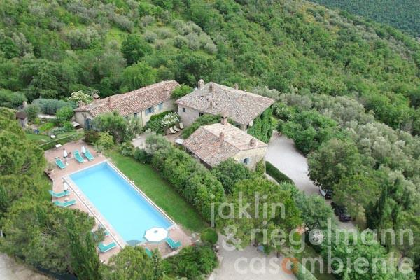 An aerial overview of the property for sale with its three main buildings, which form a beautiful courtyard