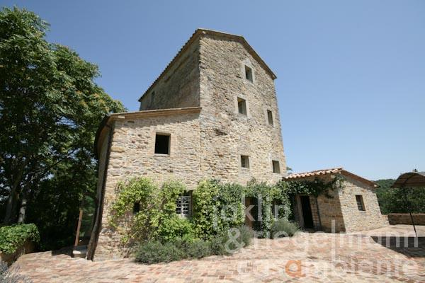 The fully restored ancient watch tower with surrounding terraces