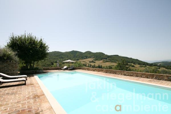 The pool terrace with panoramic views in front of the watch tower