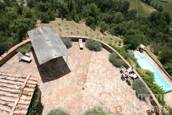 The terrace with panoramic views in front of the watch tower; the pool terrace on the right