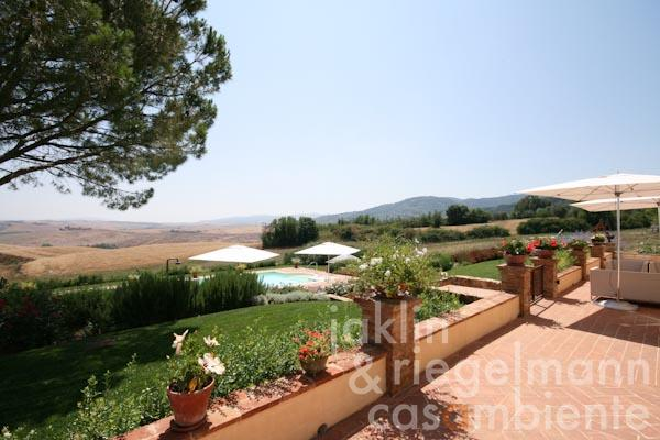 The view across the garden, swimming pool and the Tuscan landscape