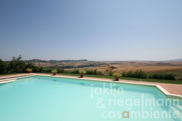 The view across the swimming pool and the Tuscan landscape