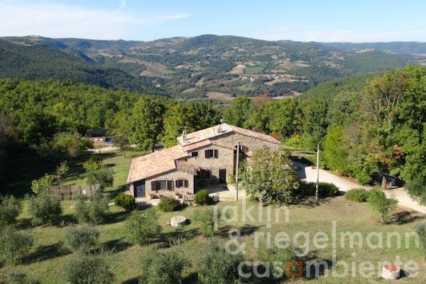 The Umbrian country estate for sale in idyllic setting with pool and olive grove close to Todi