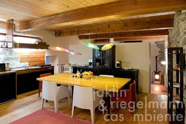 The cosy eat-in kitchen on the ground floor; in the background the living- and sleeping area