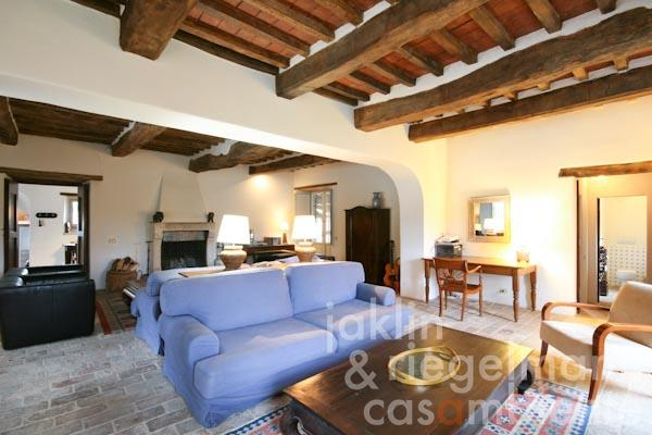 The generous living area with open fireplace and access to the loggias in the front and rear
